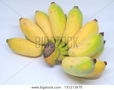 Fresh ripe bananas on white background. The bananas are healthy food. They have a lot of vitamins such as vitamin B6, manganese, vitamin C, and copper.