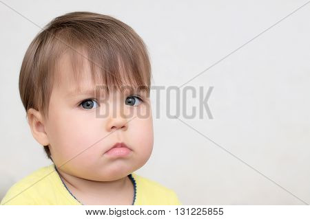 Caucasian little baby alerted watching at you