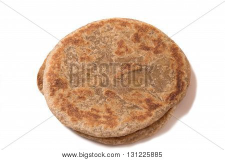 Traditional Indian Alu Paratha isolated on white background