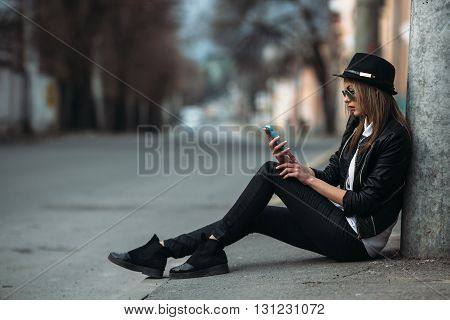 Photo of a young beautiful woman on the city street