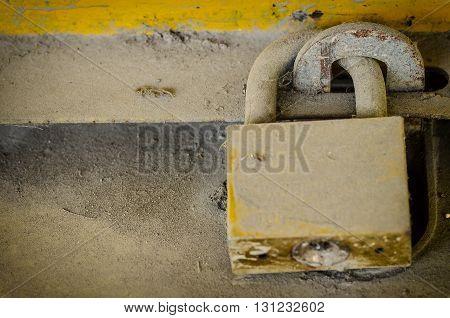 Old brass padlock with dush on metal door