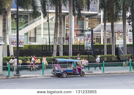 BANGKOK THAILAND - APR 17 : tuktuk is parking at CentralWorld on Ratchaprasong road on april 17 2016 thailand. tuktuk is popular taxi service of tourists in bangkok