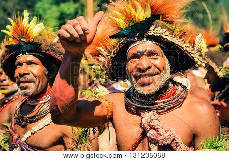 Smiling Man With Risen Hand In Papua New Guinea
