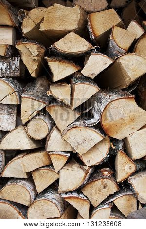 Firewood wall. Logs stacked in the woodpile