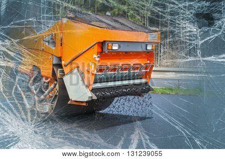 Road  orange roller flattening new asphalt, broken glass