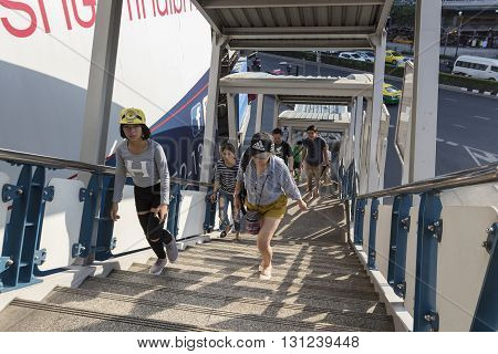 BANGKOK THAILAND - APR 24 : unidentified people walking up stairs to skywalk over Pathum Wan Junction near MBK center on april 24 2016 thailand. this skywalk link between BTS National Stadium station and Siam square