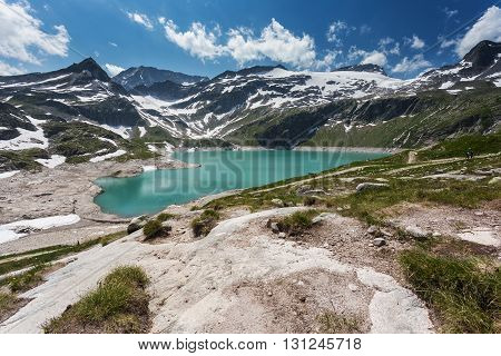 Turquoise lake in the high mountains. Summer mountain landscape. Weissee beautiful lake in Austrian mountains
