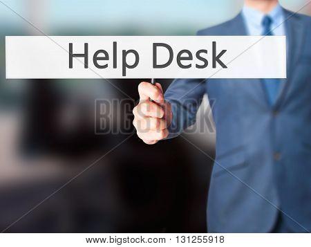 Help Desk - Businessman Hand Holding Sign