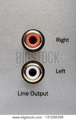 Sockets of the line output on an aluminum panel. It is a part of the rear panel of CD or DVD player.