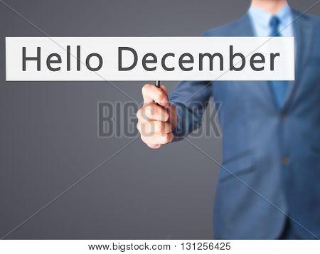 Hello December - Businessman Hand Holding Sign