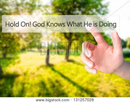 Hold On God Knows What He Is Doing - Hand Pressing A Button On Blurred Background Concept On Visual