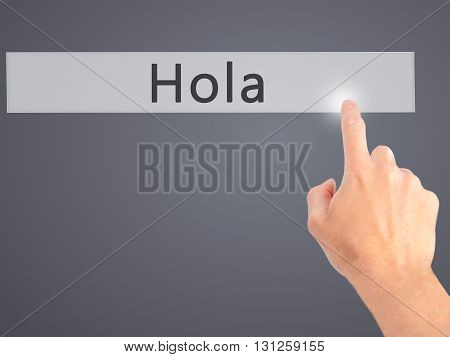 Hola - Hand Pressing A Button On Blurred Background Concept On Visual Screen.