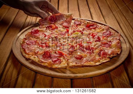 High Angle View Of Fresh Baked  Pizza   On Wooden Table