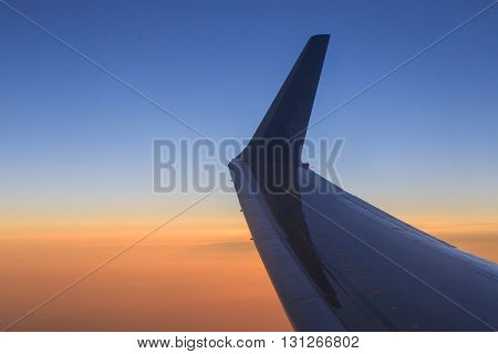 view on wing and sunset from aircraft
