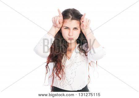 Teen Girl Making Evil Horns With Fingers.