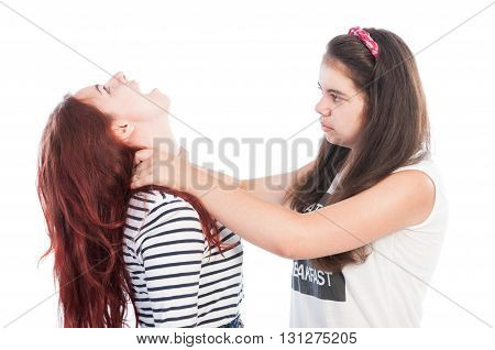 Aggressive bullying girl strangling her friend isolated on white
