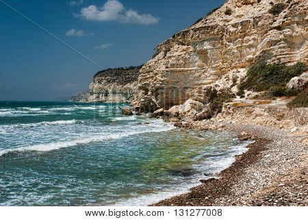 Rocky coast in Chalkidiki, Sithonia, Greece, with crystal clear water, hiding a small sandy beach