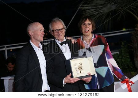 Ken Loach, screenwriter Paul Laverty  and producer Rebecca O'Brien poses  the Palme D'Or Winner Photocall during the 69th annual Cannes Film Festival at the Palais on May 22, 2016 in Cannes, France.