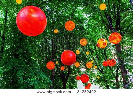 evening decoration with red lampions under the trees
