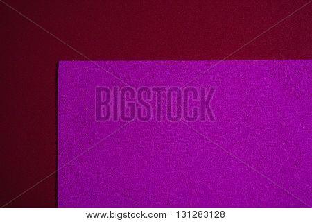 Eva foam ethylene vinyl acetate sponge plush pink surface on red smooth background