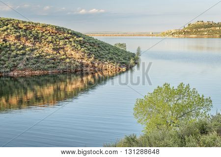 Horsetooth Reservoir with one of rock dams (Soldier Dam) at springtime, Fort Collins, Colorado