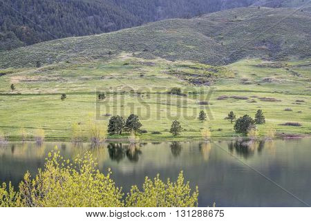 Horsetooth Reservoir and Lory State Park at COlorado foothills, springtime scenery with fresh green