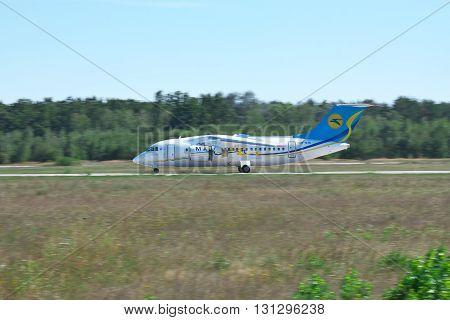 Kiev Region Ukraine - August 21 2012: Antonov An-148 regional passenger plane using jet thrust reverser on runway after landing