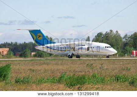 Kiev Region Ukraine - August 21 2012: Antonov An-148 regional passenger plane on runway after landing