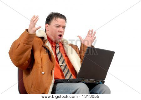 Young Surprised Looking  Businessman Working On Laptop