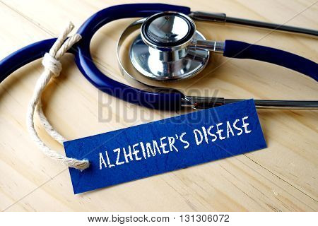 Medical Conceptual Image With Alzheimer's Disease Word Written On Label Tag And Stethoscope On Woode