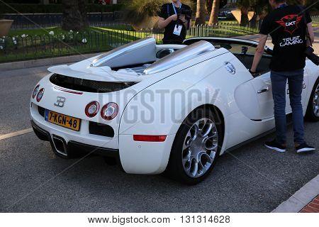Monte-Carlo Monaco - May 17 2016: White Supercar Bugatti Veyron 16.4 Grand Sport (Rear View) Parked in Front of the Grimaldi Forum in Monaco