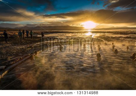 Hotspring swim during sunrise in Salar Uyuni Bolivia
