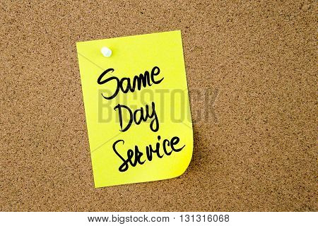 Same Day Service Written On Yellow Paper Note