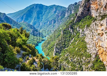 The largest alpine canyon Verdon spring. Emerald  river is flowing at the bottom of the gorge. Canyon of Verdon, Provence, France