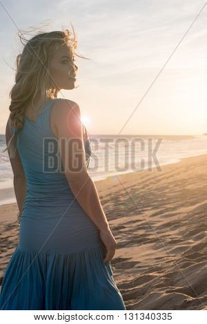 Portrait of a pretty girl relaxing at the beach during a summer day.