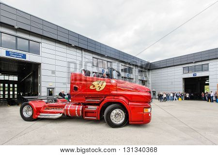 KIEV,UKRAINE - May,21: Customized truck Red Pearl  Scania R999 by Svempas Customs leaves from repair hangar during the celebration of 125 anniversary of Scania company in Kiev,Ukraine May 21,2016.
