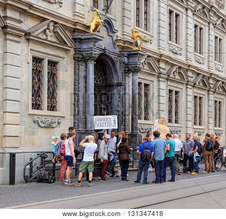 Zurich, Switzerland - 25 May, 2016: people with banners at the entrance to the Zurich Town Hall building. Zurich Town Hall (German: Zurich Rathaus) houses the cantonal parliament (German: Kantonsrat) and the city parliament (German: Gemeinderat).