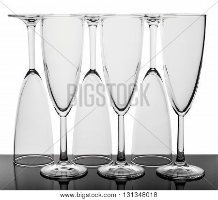 Set of six wine glasses. Glasses standing in a row three glasses upside down. Isolated on the white background.