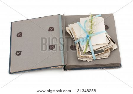 Open photo album with old photos isolated on white background.