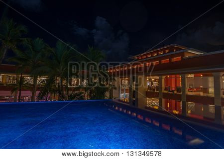 PUNTA CANA DOMINICAN REPUBLIC - CIRCA OCTOBER 2015: Night scenic view of five stars all inclusive hotel Barcelo Bavaro Palace in Punta Cana October 2015. Punta Cana is world famous tropical resort.