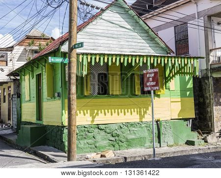 ROSEAU DOMINICA - MAI 5 2016: scenic wooden hut in the quarter Carib Territory in Rouseau. The hut style is typical for Roseau architecture.