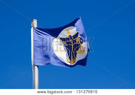PRINCIPALITY OF HUTT RIVER,WA,AUSTRALIA-APRIL 20,2016: Blue flag representing the unique Sovereign State, the Principality of Hutt River, independent oldest micro nation located in Western Australia waving in a clear blue sky.