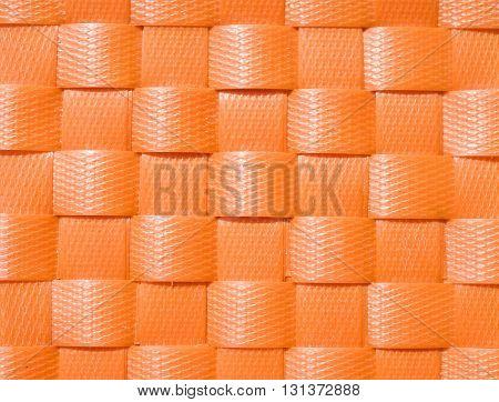 Orange weave plastic wicker pattern for background.