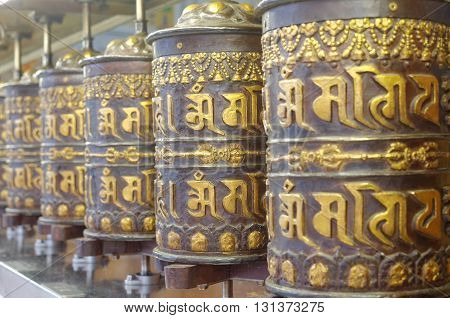 prayer wheels in thekchen choling temple singapore