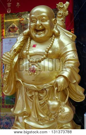 laughing buddha also known as the buddha of wealth