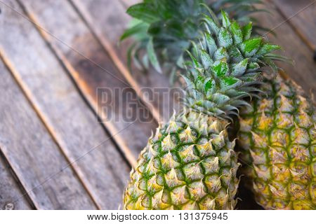 fresh pineapple on wooden background, tropical fruit