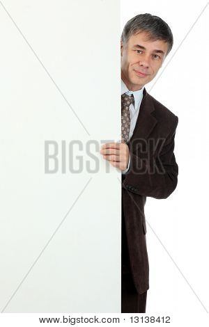 Business background: handsome businessman with white dysplay