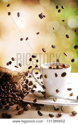 Cup Of Coffee With Green Nature Background Vertical Composition