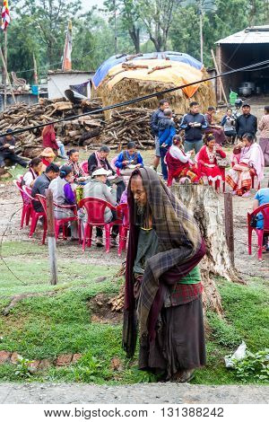 KathmanduNepal - May 212016 : A poor Nepali Man is around the party venue with hoping to get something to eat.