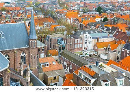 Delft, Netherlands - April 8, 2016: Aerial panoramic downtown street view with church and houses in Delft, Holland